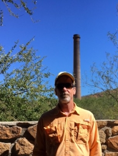 Mitch with Ramona the smoke stack behind him (yes, they named the smokestack).